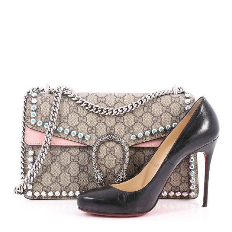 43e47b09d4c This authentic Gucci Dionysus Handbag Crystal Embellished GG Coated Canvas  Small named after the Greek God