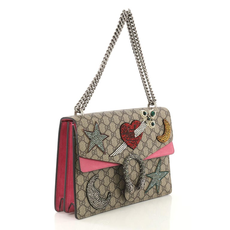 a1cfe69f3 This Gucci Dionysus Handbag Embellished GG Coated Canvas Medium, crafted  from brown embellished GG coated