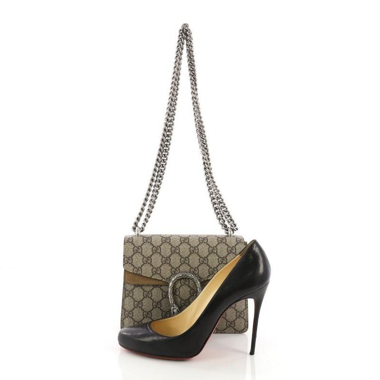 55002c2d6 This Gucci Dionysus Handbag GG Coated Canvas Mini, crafted in brown GG  coated canvas,