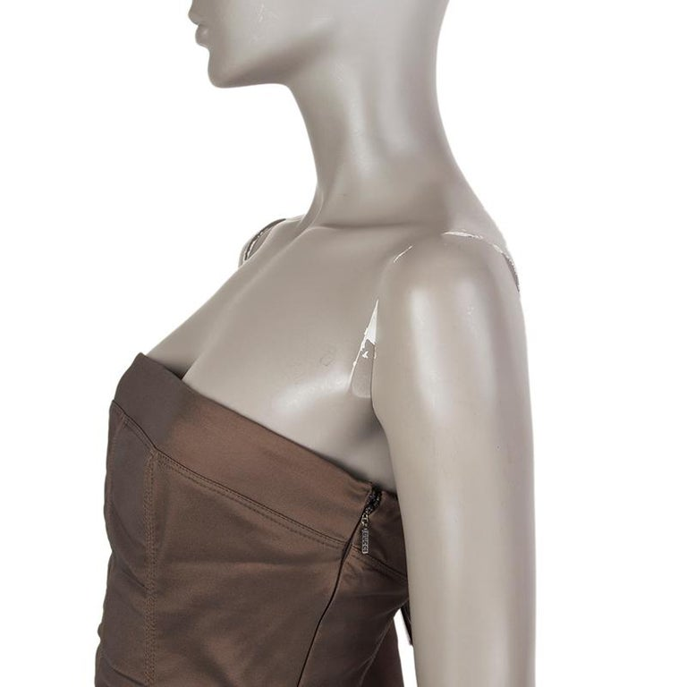 Gucci bustier sheath dress in dark drab olive rayon (60%), nylon (35%) and spandex (5%). Two front zipper pockets. Opens with zipper on the back. Partially lined. Has been worn and is in excellent condition.  Tag Size 44 Size L Bust To 86cm