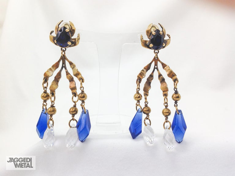 Gucci Chandelier Clip On Earrings   Incredible statement drop earrings from Gucci. Cast from antiqued effect gold-plated brass and set with crystals and blue beads. Lightweight and easy to wear.   Size & Fit -Drop: 10cm / 4.1in -Width: 1.1 in -