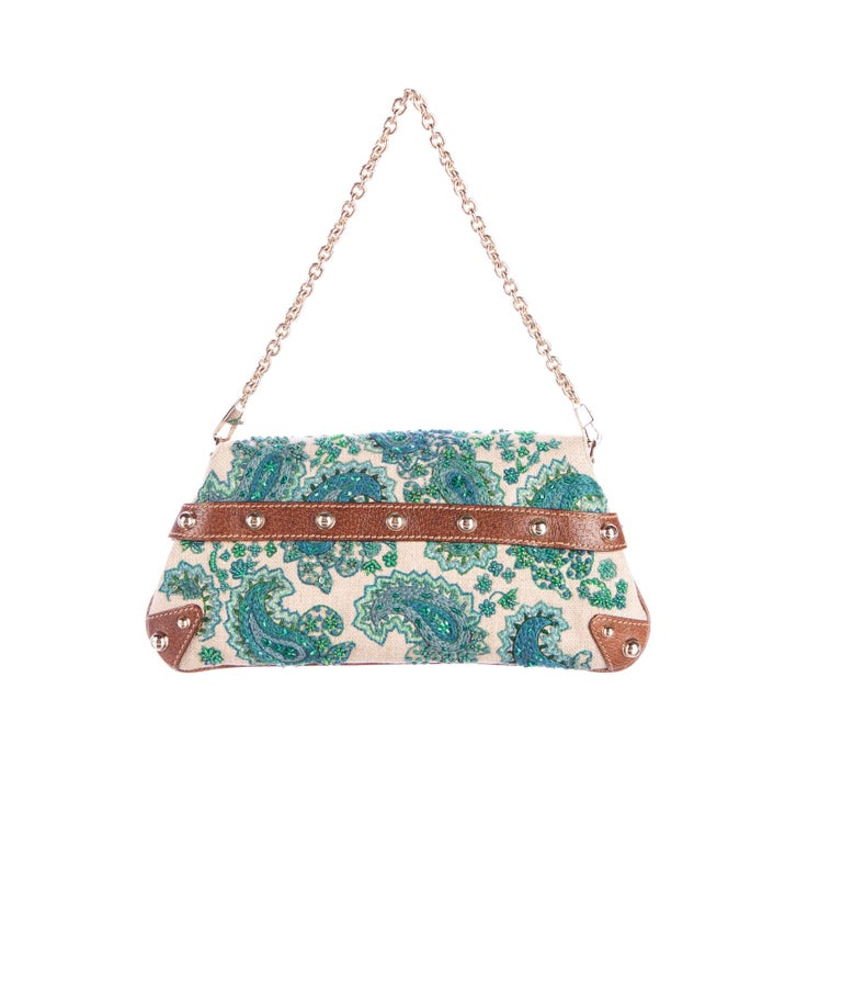Stunning Gucci signature bag Embroidered in paisley pattern with turquoise sequins and pearls Bamboo horsebit detail Leather trimming Mat-gold hardware Fully lined Detachable strap engraved with