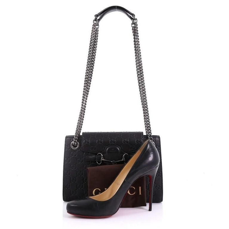 587b93b7261c16 This Gucci Emily Chain Flap Shoulder Bag Guccissima Leather Small, crafted  in black guccissima leather