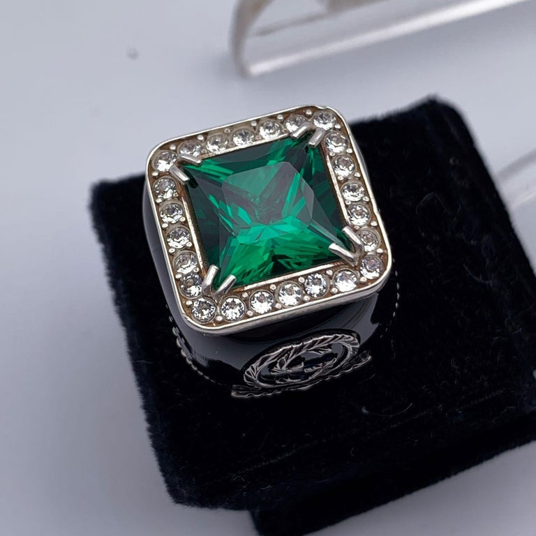 Beautiful GUCCI Sterling Silver Statement Ring. Signet style. Crafted of aged finish sterling silver 925 and black enamel. Big green princess cut synthetic stone on top trimmed with clear crystals. GG - Gucci logo detailing. Size: 11 IT (15 3/4 US