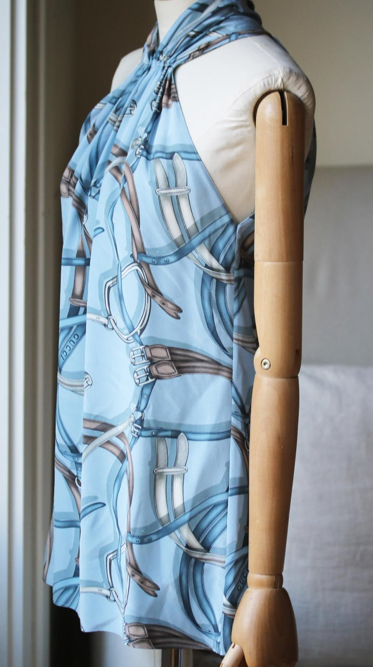 Part of Gucci's Equestrian collection. Equestion-print. Zip and hook fastening down the back. Halter neck, loose fit. 100% silk. Colour: blue.   Size: IT 42 (UK 10, US 6, FR 38)  Condition: As new condition, no sign of war.