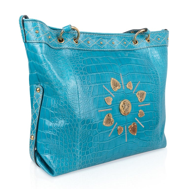 Guaranteed authentic Gucci exclusive Limited Edition Turquoise fabulous large tote style bag featured in the softest, lightest Crocodile ever.  This roomy treasure is a fantastic every day and travel bag!  Magnificent color in a semi gloss skin.