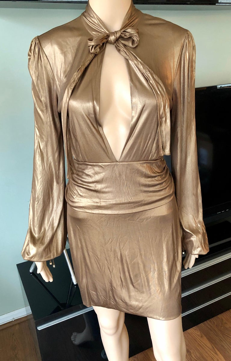 Gucci F/W 2006 Runway Plunging Neckline Gold Metallic Mini Dress Size S  Gucci gold metallic mini dress featuring plunging neckline, long sleeves and tie accents at neck. From the Fall 2006 Collection.