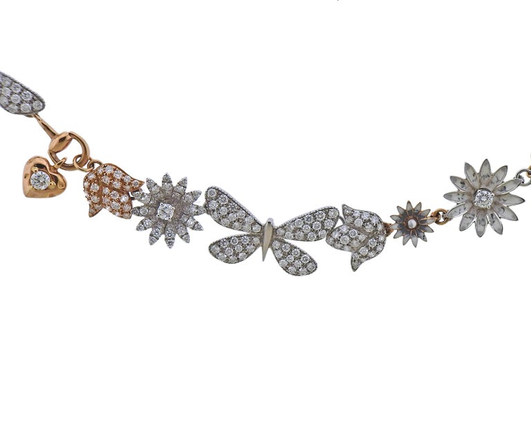 Impressive Limited Edition Flora necklace by Gucci, set in 18k rose and white gold, with approx. 2.83ctw in G/VS diamonds.  With box and papers. Necklace is 16.5