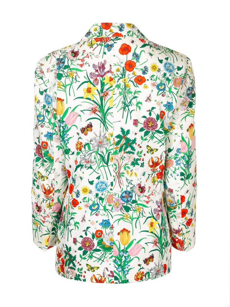 Gucci Flora cotton blazer jacket featuring the famous and emblematic Accornero floral print, signed 'Gucci' in the print, a silk logo front pockets, padded shoulders, long sleeves. In good vintage condition. Made in Italy Estimated size: