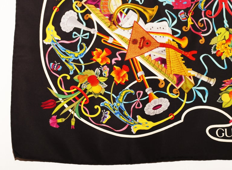 Gucci Floral Music String Instrument Silk Scarf 1990´s What a vibrant colored scarf! Musical Instruments Floral Motif Mint  Made in Italy 100% silk 34' x 34' square  Shipment of this piece is not affected by COVID-19. Orders welcome!*  Our Company