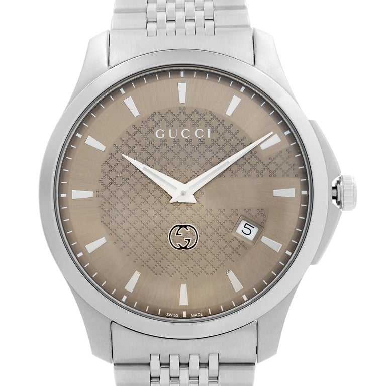 Pre-owned Gucci G-Timeless 40mm Stainless Steel Brown Dial Quartz Men's Watch YA126349. The Watch Fits a 7.5-inch Wrist. Timepiece Might have Some Tiny Scratches on Caseback. No Original Box and Papers are Included. Comes with Chronostore