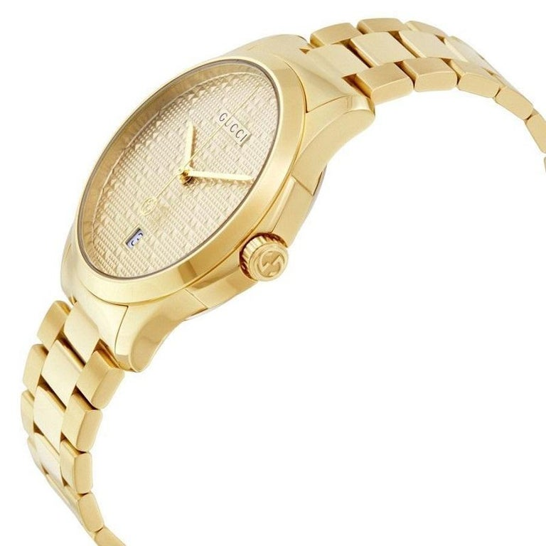 Case: Stainless steel Case back: Stainless steel, screw-down Bezel: Gold tone stainless steel Dial: Gold-Tone Hands: Gold-Tone Calendar: Date display appears at the 6 o'clock position Bracelet: Gold-Tone stainless steel links Clasp: