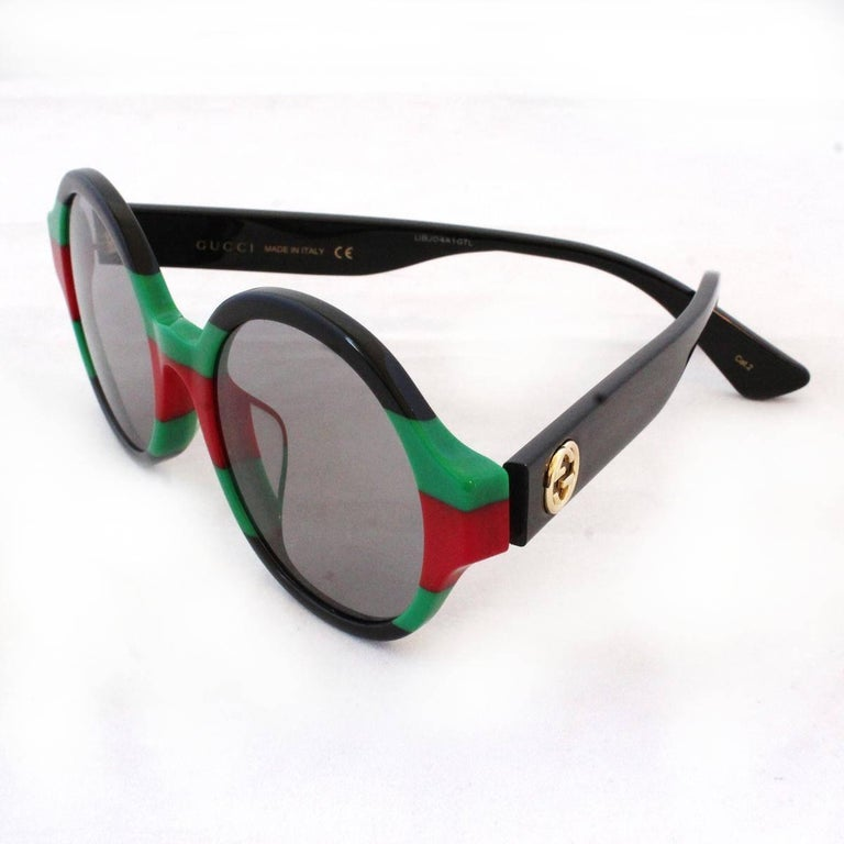 Brand new Gucci sunglasses Round frames Black, green and red color With case Width cm 14 (5.5 inches) Condition: New with case Worldwide express shipping included in the price !