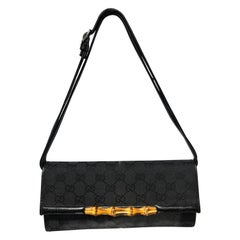 Gucci GG Canvas Bamboo Bar Clutch with Shoulder Strap