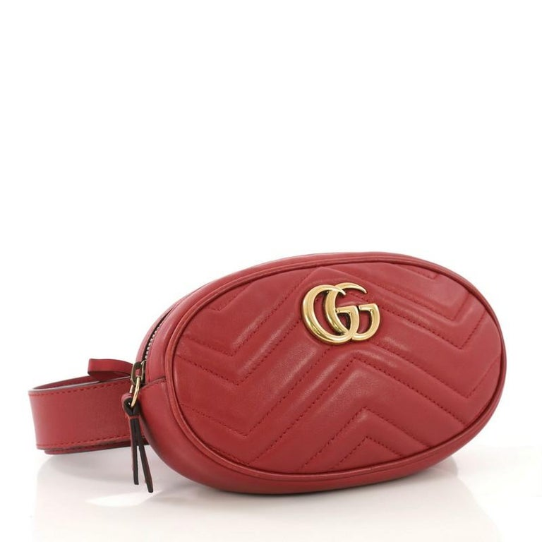 This Gucci GG Marmont Belt Bag Matelasse Leather, crafted in red matelasse quilted leather, features adjustable belt strap, GG logo at front and aged gold-tone hardware. Its zip closure opens to a beige microfiber interior with slip pocket.