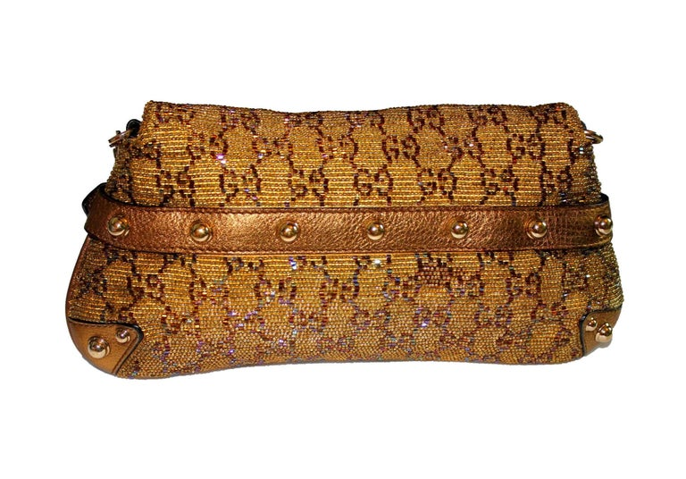 A limited edition bag by Gucci A signature piece in the famous GG Monogram Beautiful beaded Gucci bag in golden color with metallic leather trimming Famous Gucci signature horsebit design Gold-colored hardware Detachable strap discreedly engraved