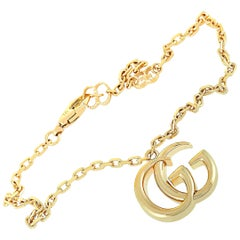 Gucci GG Running 18 Karat Yellow Gold Double G Charm Bracelet