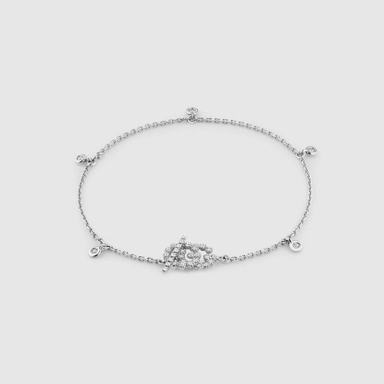 The Double G, inspired by an archival design from the '70s-a hallmark era of the House-is elevated in 18k white gold. White diamonds on the charm, toggle and along the chain bracelet further enrich the design. 18k white gold 37 round brilliant cut