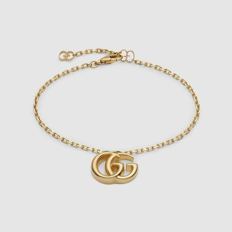 The Double G, inspired by an archival design from the '70s—a hallmark era of the House—is elevated in 18k yellow gold. 18k yellow gold Adjustable clasp closure Pendant: .75