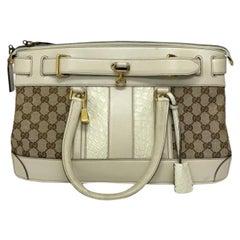 Gucci GG Supreme bag in Supreme Fabric and White Leather Trim
