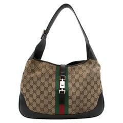 Gucci GG Supreme canvas hobo bag with interlocking Hardware
