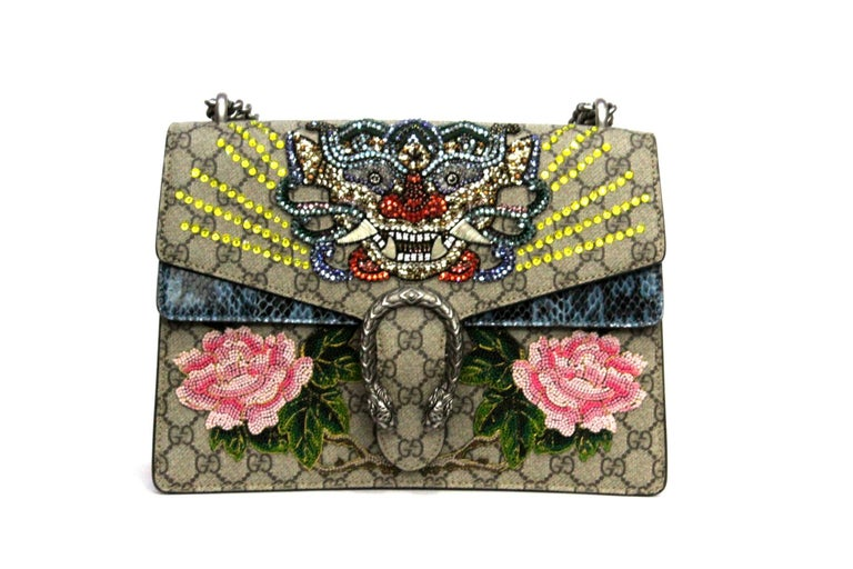 Gucci bag Dionysus model made with the classic GG canvas in ebony and embellished with patches sewn on the front and python finishes.
