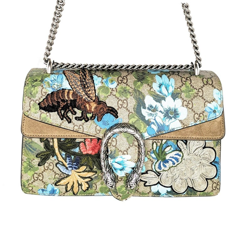 Designer: Gucci Material: Beige GG coated canvas with fabric applique Origin: Italy Colors: Multi-color Date/Authenticity Code: 400249.486628 Measurements: 11