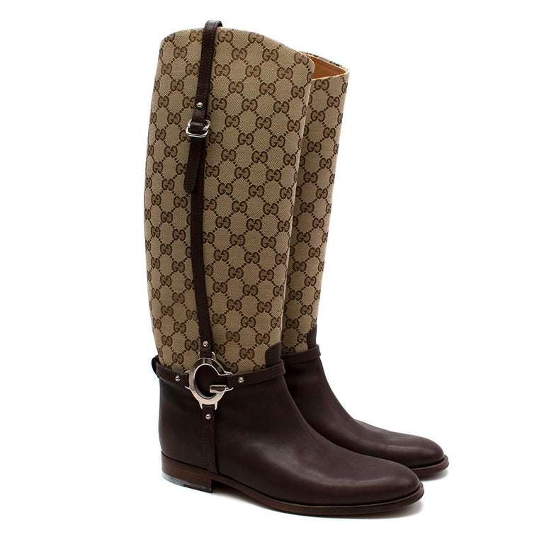 Gucci GG Supreme Leather Knee High Boots  - Gucci GG Supreme logo boots - Knee length - Brown leather toe with canvas leg - Leather buckle detailing  - 'G' silver metal hardware buckle emblem  - Leather sole and inner lining  - Pull on style  - EU