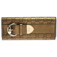 Gucci Gold Guccissima Leather Buckle Continental Wallet