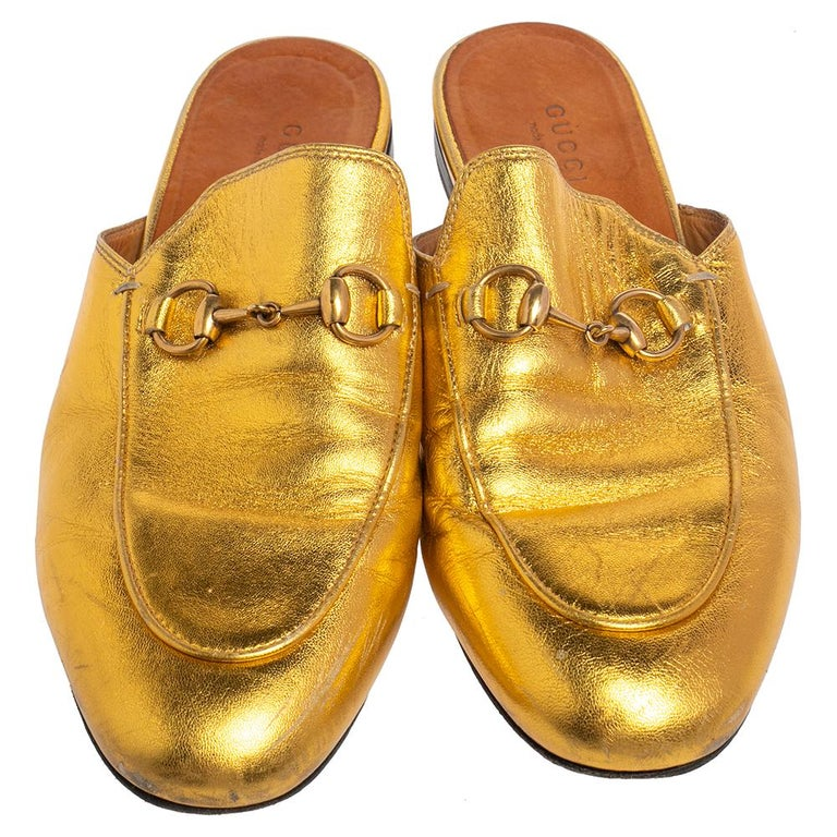 These Gucci Princetown mules are a fresh update on the perennially chic Gucci Horsebit loafers. They have an open-back design and the signature Horsebit motif laid on the gold leather exterior.  includes: Original Dustbag