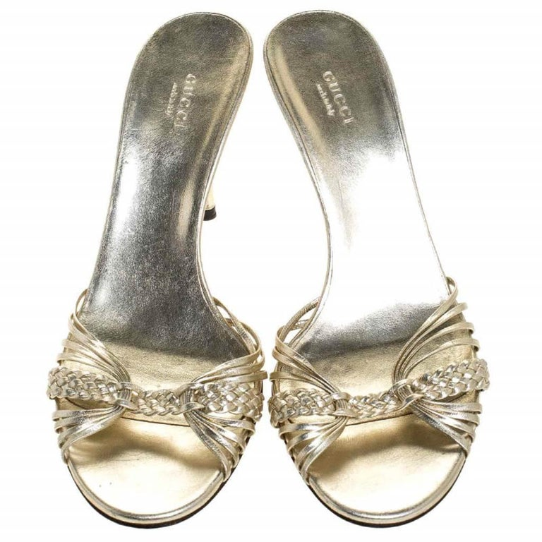 How splendid are these sandals from Gucci! They come designed with braided leather straps which add to the beauty of the pair. The slides carry leather insoles and a set of 9.5 cm heels artistically sculpted with bamboo accents.  Includes: The