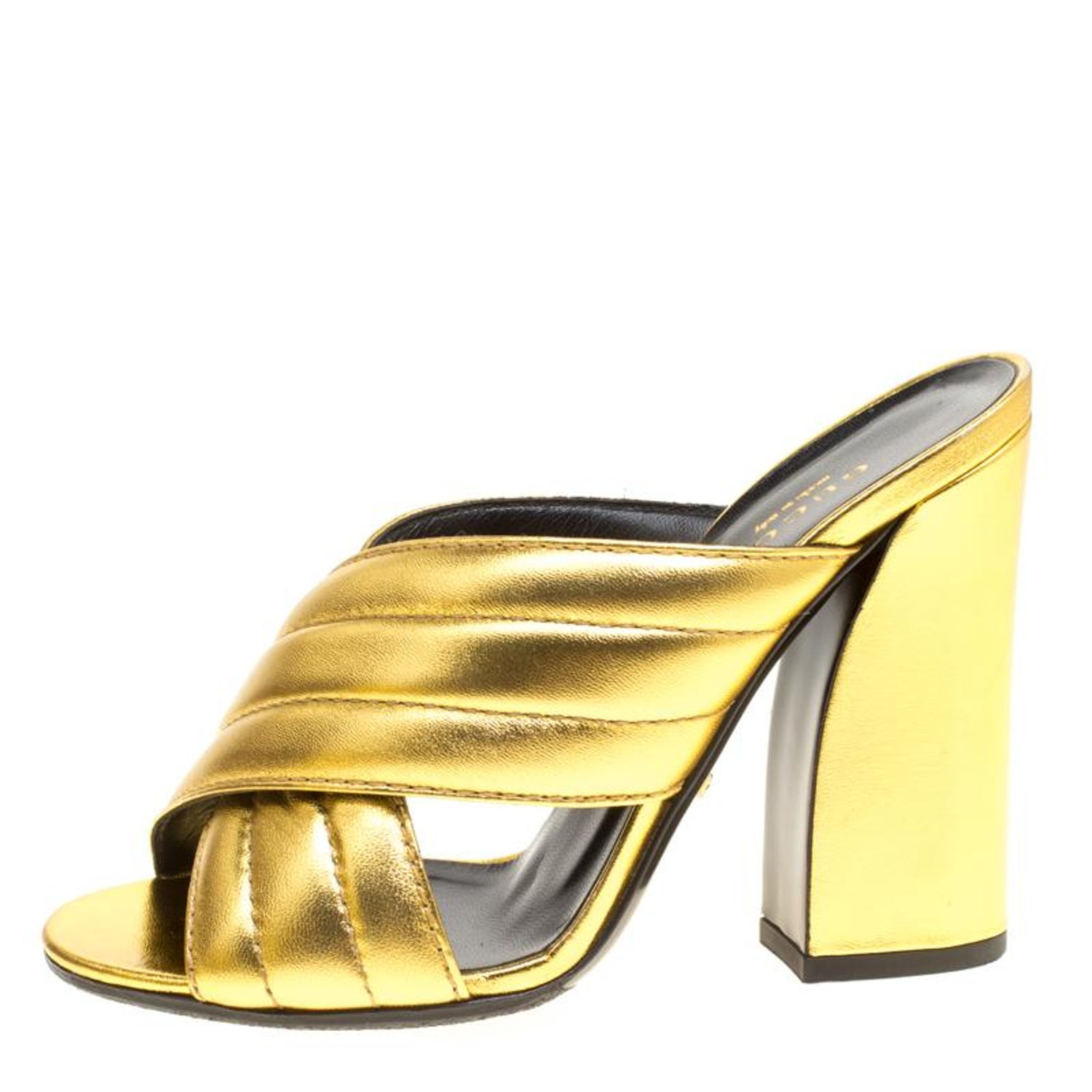 3dc14af1698 Gucci Gold Metallic Leather Sylvia Crossover Mules Size 37 at 1stdibs