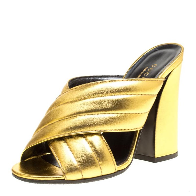 10a16d91206 Gucci Gold Metallic Leather Sylvia Crossover Mules Size 37 at 1stdibs