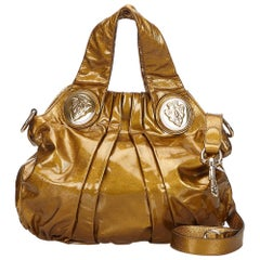 Gucci Gold Lackleder Hysterie