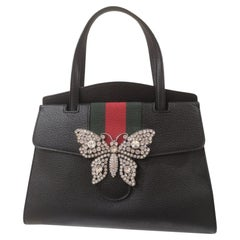 Gucci grained calfskin web butterfly handle bag