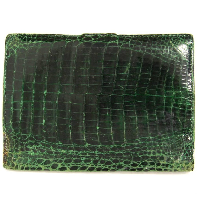 29c772e8042 Marvelous Gucci cardholder made with crocodile leather in a deep green  color