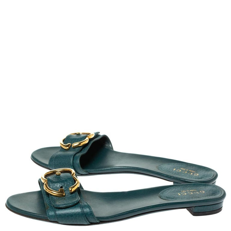 Put your best foot forward this season in these pretty Gucci sandals. These green sandals have been crafted from leather in Italy and they feature gold-tone GG buckle on the vamps as well as insoles meant to provide comfort at every step. These