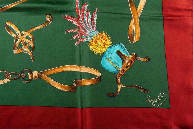 Gucci 100% silk scarf in green with red trim. Birds design. Hand rolled edges.