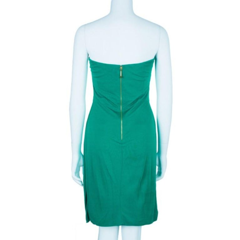 Welcome summer with this fun Gucci green strapless gathered cocktail dress. It is perfect to wear on a day out to the beach or for an evening outing. It features a gorgeous green color, pleated fabric on the chest area that is gathered with a