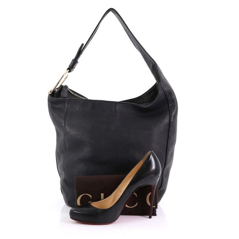 473989f2f0ef93 This Gucci Greenwich Hobo Leather Large, crafted in black leather, features  a single asymmetrical