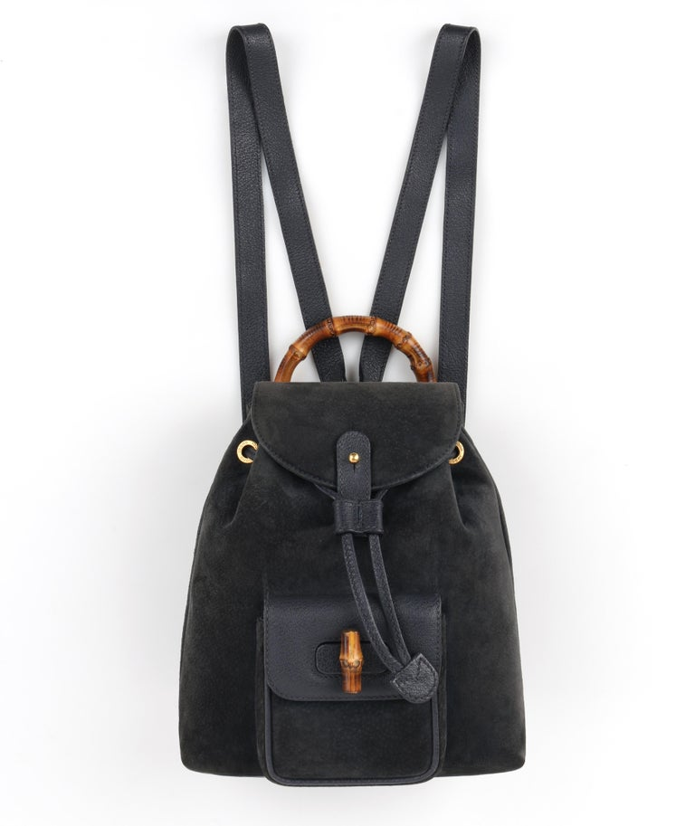 DESCRIPTION: GUCCI Suede & Leather Bamboo Handle Mini Drawstring Backpack   Estimated Retail: $1,295   Brand / Manufacturer: Gucci Collection:  Designer: Manufacturer Style Name:  Style: Mini backpack Color(s): Dark slate gray/blue and navy