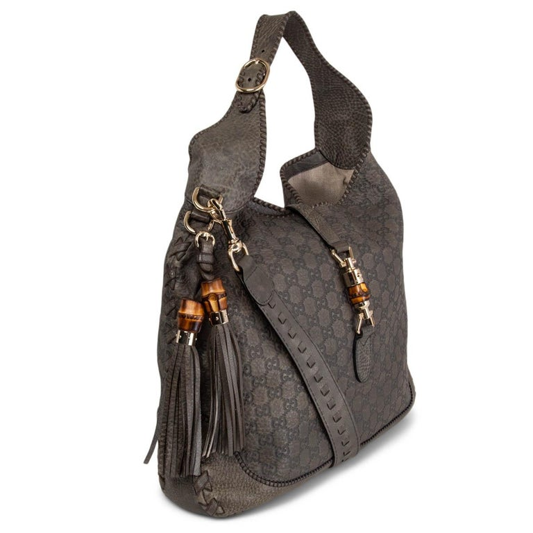 100% authentic Gucci New Jackie Large hobo shoulder bag in petrol-grey grained and Guccissima embossed calfskin featuring light gold-tone hardware and bamboo detail lock. Lined in off-white canvas with one zipper pocket against the back and two