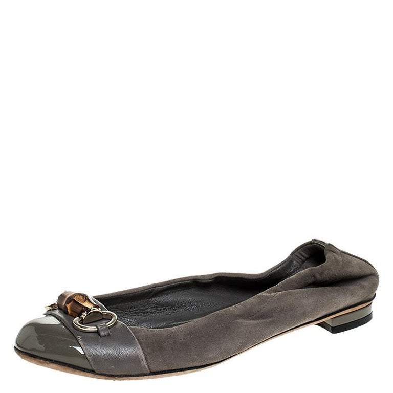 This pair of Gucci's flats combine comfort with style. Crafted from suede and leather, they feature round toes and Horsebit motifs with bamboo on the uppers. This pair can be teamed up well with casuals.  Includes: Original Dustbag