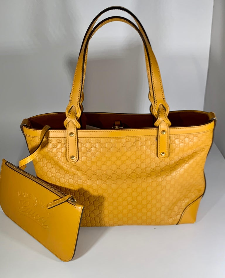 This Is An Authentic, Pre-Owned Piece but looks like brand New. Its in Excellent condition . The Gucci Leather Small  Bag is big enough for all that we need to carry. The sleek bag features soft and supple Yellow  Guccissima leather and gold tone