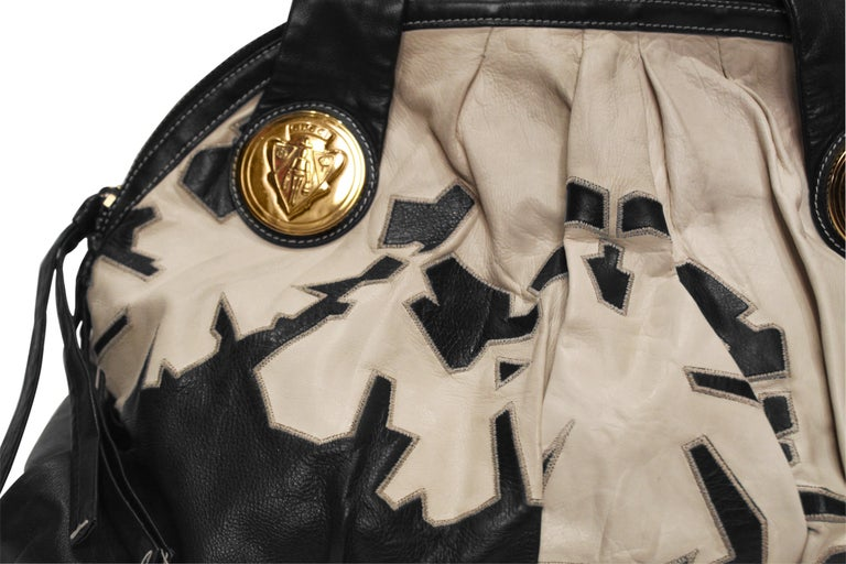 Striking black and white Gucci Hysteria satchel hobo bag in buttery soft leather. Comes with detachable shoulder strap.