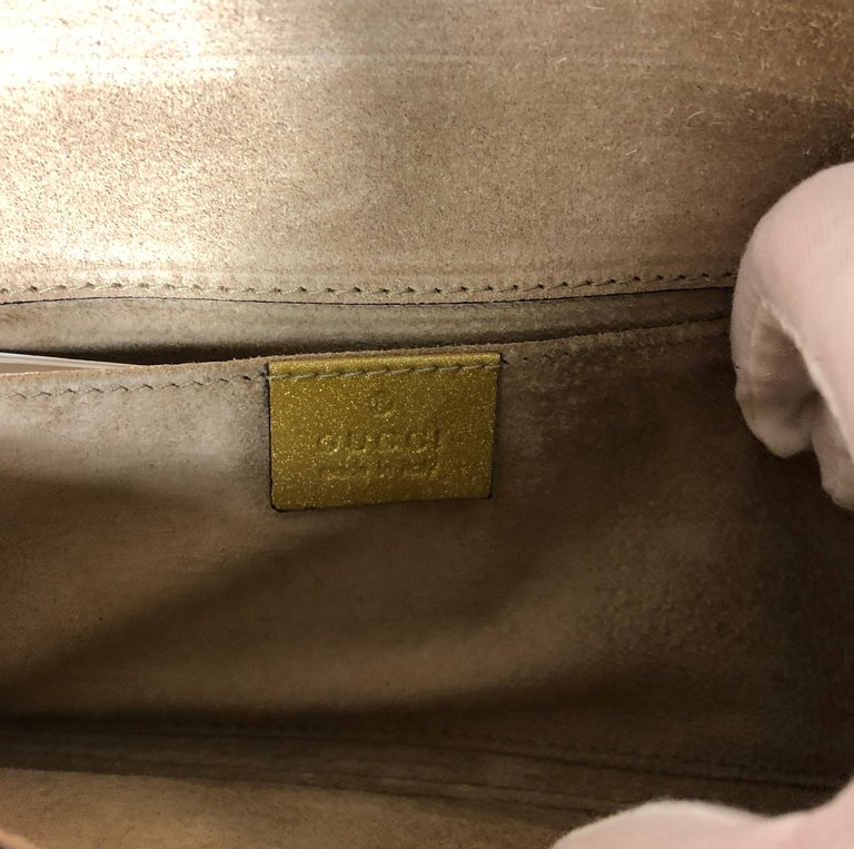 Gucci Iridescent Gold Patent Leather Elongated Clutch with Gold Metal Accents For Sale 11