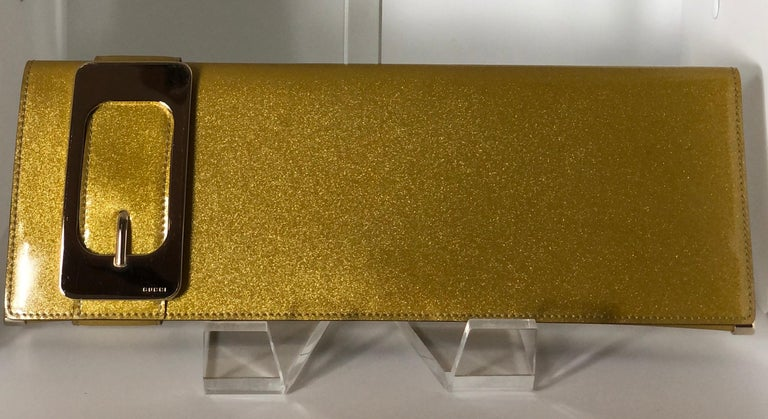 Brown Gucci Iridescent Gold Patent Leather Elongated Clutch with Gold Metal Accents For Sale