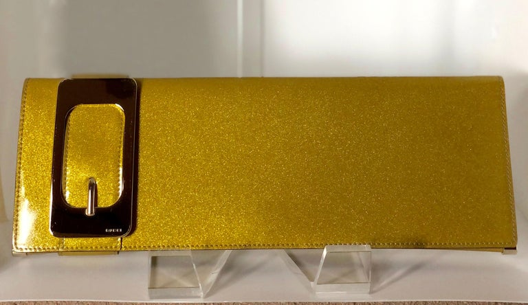 Gucci Iridescent Gold Patent Leather Elongated Clutch with Gold Metal Accents In Good Condition For Sale In Houston, TX