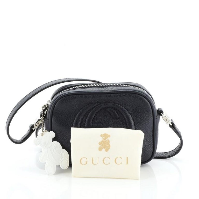 This Gucci Kid's Soho Disco Crossbody Bag Leather Mini, crafted from blue leather, features stitched interlocking GG logo on the front, leather tassel, long comfortable adjustable strap and silver-tone hardware. Its top zip closure opens to a