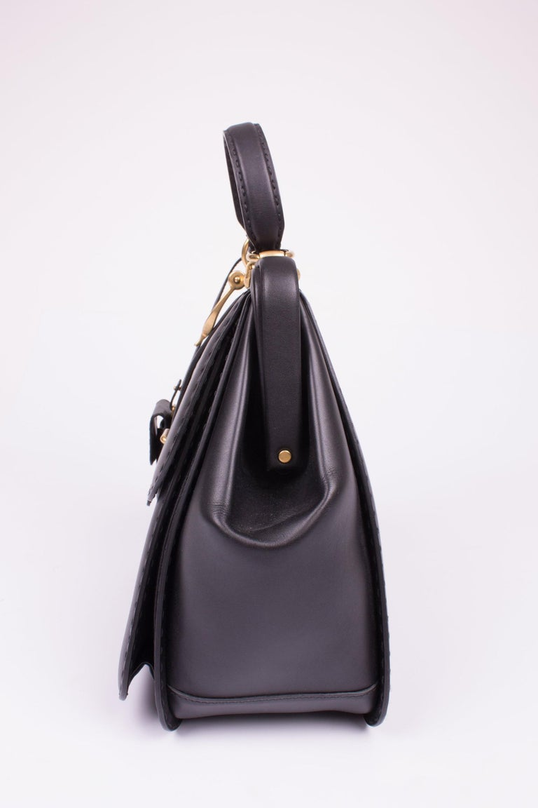 7fc78baaac5d Gucci Lady Stirrup Top Handle Bag Limited Edition - black leather For Sale.  This is a very rare piece; number 146 out of 224 made. It is